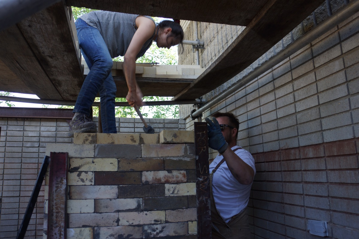 Need a chimney built?  Rebecca Wong from Vancouver can really swing a mallet.  Helping out is Zach Quin, Smiling Cow Studio, Maple CreekSaskatchewan