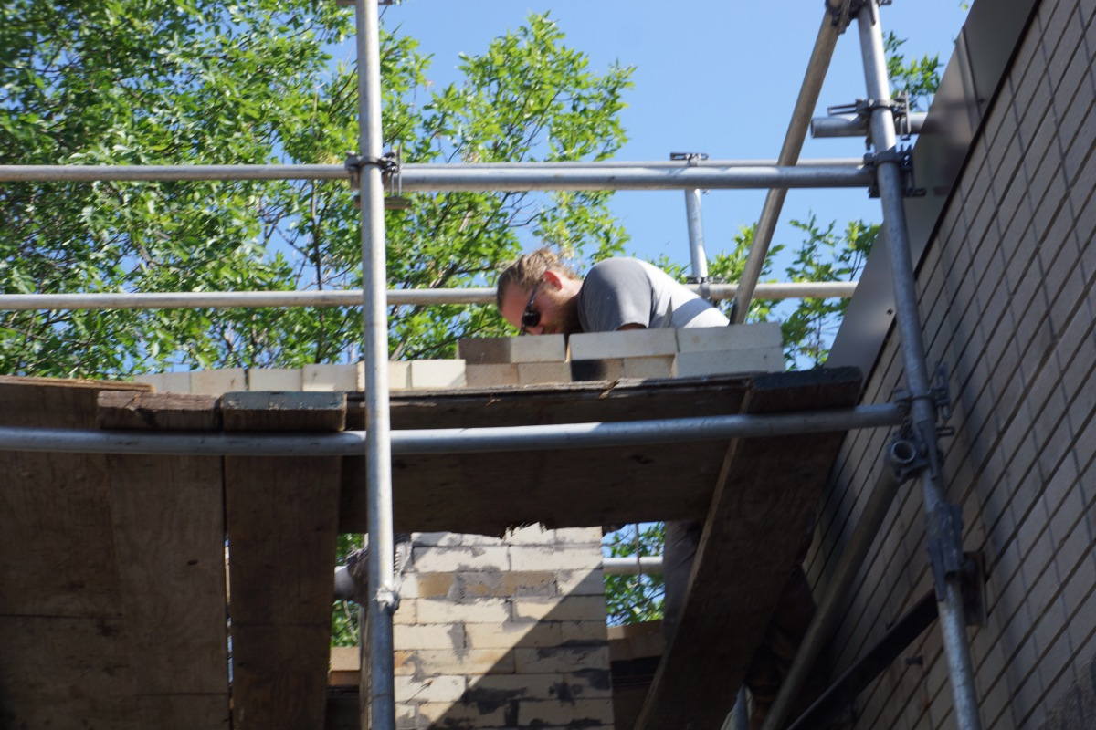 End of Day 5:  The Kiln is Finished!  Matt Boyd laid the last brick in the last course of the chimney around 4:45pm.Wow.